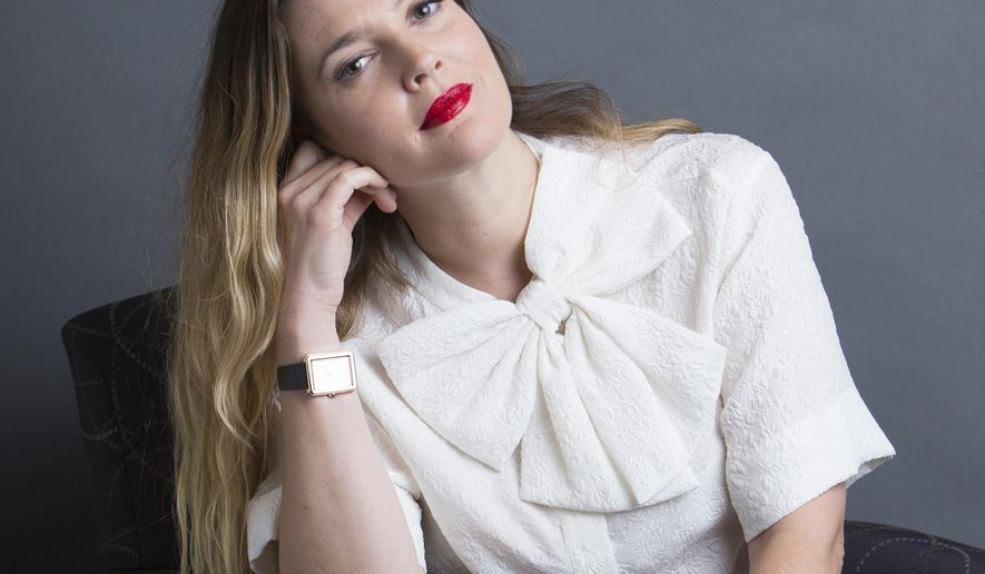 """In this Oct. 20, 2015 photo, Drew Barrymore poses for a portrait to promote her new book """"Wildflower,"""" in New York. Barrymore has a new movie, """"Miss You Already,"""" with Tony Collette opening Nov. 6,  a beauty line called Flower and runs a production company called Flower Films.  (Photo by Amy Sussman/Invision/AP)"""