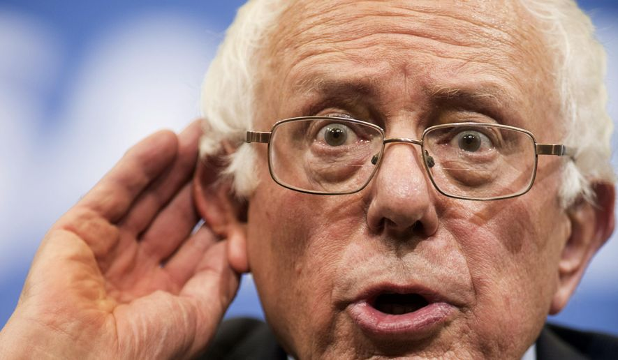 Democratic presidential candidate Sen. Bernie Sanders, I-Vt., listens to a student's question at a town hall meeting at George Mason University in Fairfax, Va., on Wednesday, Oct. 28, 2015.  (AP Photo/Kevin Wolf)