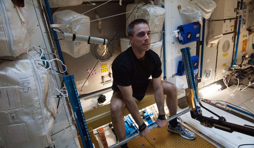 In this Aug. 31, 2013 photo made available by NASA, astronaut Chris Cassidy, Expedition 36 flight engineer, exercises on the advanced Resistive Exercise Device (aRED) in the Tranquility node of the International Space Station. In an extensive audit released Thursday, Oct. 29, 2015, NASA's inspector general office looked at the space agency's overall effort to keep astronauts healthy during lengthy space missions _ especially trips to Mars, currently targeted for the 2030s. (NASA via AP)