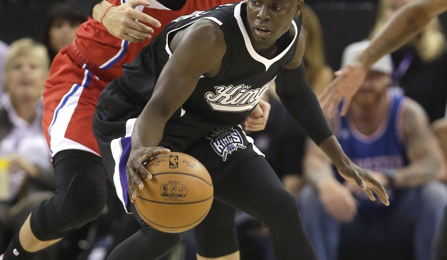 Sacramento Kings guard Darren Collison, right, protects the ball from Los Angeles Clippers guard Austin Rivers during the first quarter of an NBA basketball game in Sacramento, Calif., Wednesday, Oct. 28, 2015. (AP Photo/Rich Pedroncelli)