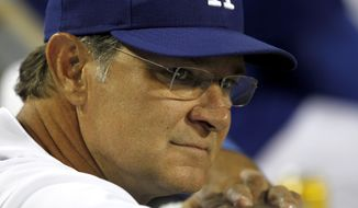 Los Angeles Dodgers manager Don Mattingly looks on from the dugout before a baseball game against the Arizona Diamondbacks in Los Angeles, Wednesday, Sept. 23, 2015. (AP Photo/Alex Gallardo)