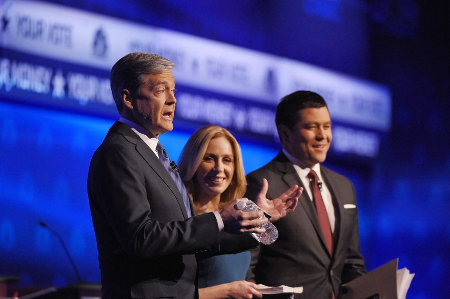 Moderators (from left) John Harwood, Becky Quick and Carl Quintanilla take the stage for the CNBC Republican presidential debate Wednesday at the University of Colorado in Boulder. (Associated Press)