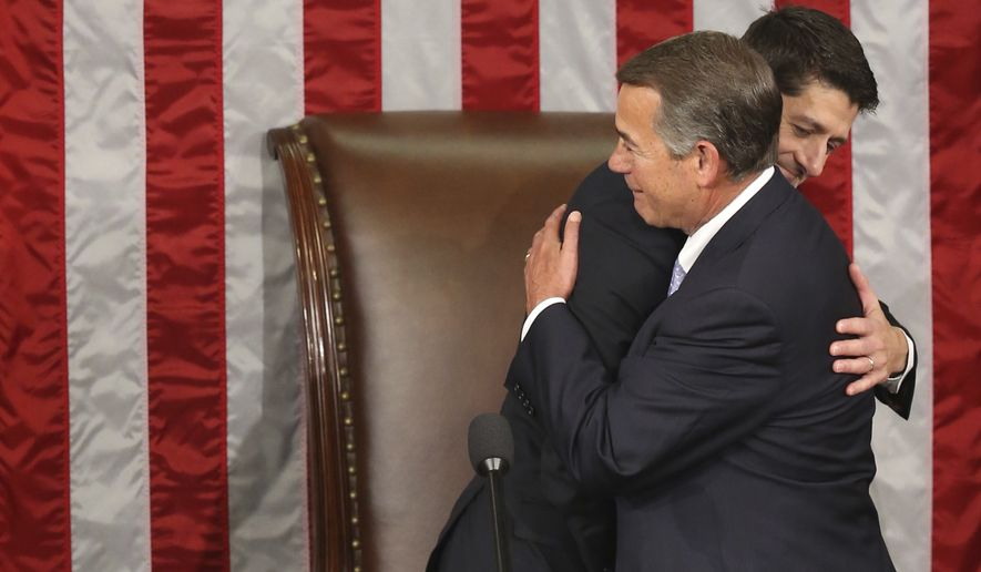 Outgoing House Speaker John A. Boehner hugs his successor Rep. Paul Ryan in the House Chamber on Capitol Hill in Washington on Thursday. (Associated Press)