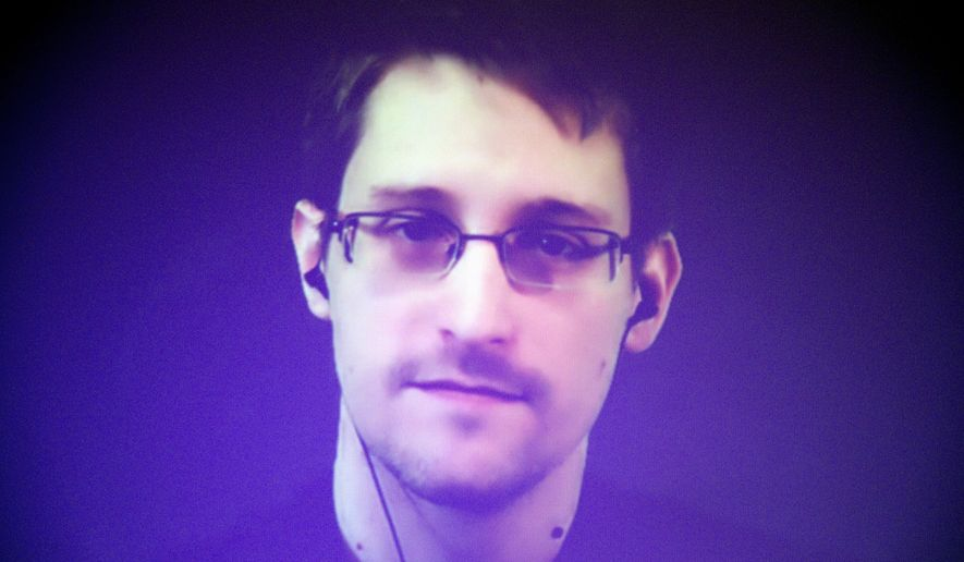 In its non-binding vote, the European Parliament called on its member states to protect Edward Snowden from extradition and drop any criminal charges of their own. (Associated Press)
