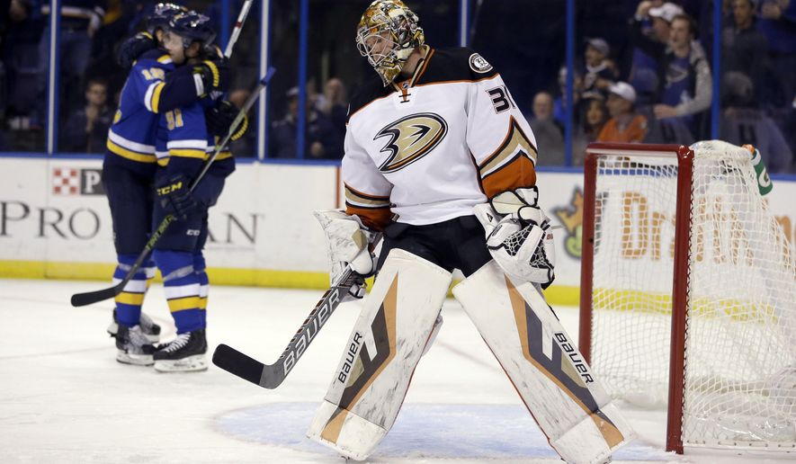 Anaheim Ducks goalie Frederik Andersen, of Denmark, pauses as St. Louis Blues right wing Vladimir Tarasenko, center, of Russia, is congratulated by teammate Jori Lehtera, of Finland, after scoring during the second period of an NHL hockey game Thursday, Oct. 29, 2015, in St. Louis. (AP Photo/Jeff Roberson)