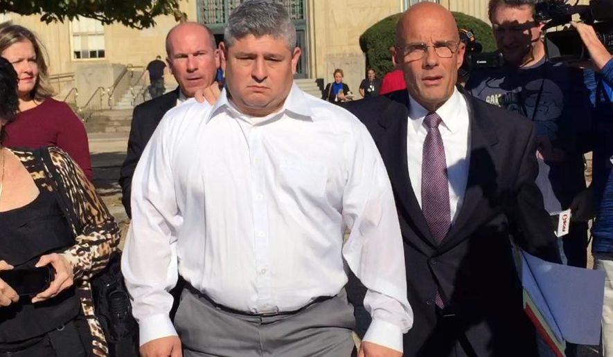 Hempstead Village Police Officer Louis Arcila, center, leaves court in Mineola, N.Y., accompanied by his attorney William Petrillo, after pleading not guilty to sexual abuse and official misconduct charges, Thursday, Oct. 29, 2015. Authorities allege that Arcila groped a woman after she ignored him when he threatened to issue her a summons during an off-duty encounter in a restaurant on June 28, 2015. (AP Photo/Michael Balsamo)