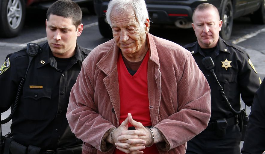 Former Penn State University assistant football coach Jerry Sandusky, center, arrives at the Centre County Courthouse for a hearing about his appeal on his child sex-abuse conviction, in Bellefonte, Pa., Thursday, Oct. 29, 2015. (AP Photo/Gene J. Puskar)