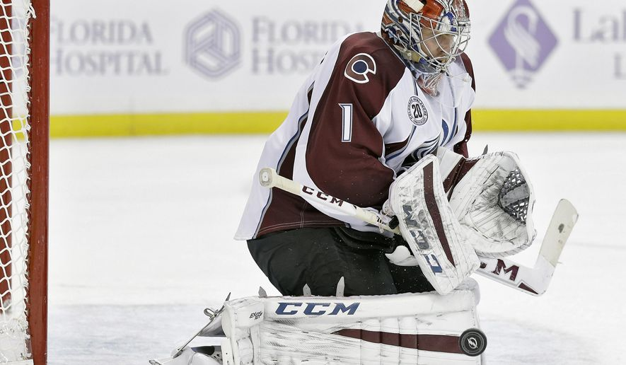 Colorado Avalanche goalie Semyon Varlamov (1), of Russia, makes a save on a shot by the Tampa Bay Lightning during the second period of an NHL hockey game Thursday, Oct. 29, 2015, in Tampa, Fla. (AP Photo/Chris O'Meara)