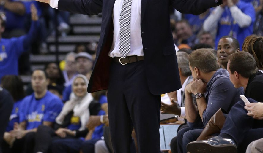 FILE - In this Oct. 27, 2015, file photo, Golden State Warriors interim head coach Luke Walton gestures on the sideline during the second half of an NBA basketball game against the New Orleans Pelicans in Oakland, Calif. Walton had the Golden State players fooled as all cool and calm before his debut as an NBA head coach, with boss Steve Kerr watching from nearby in the locker room and his father Bill in the stands. (AP Photo/Ben Margot, File)