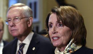 Senate Minority Leader Harry Reid (left) of Nevada listens as House Minority Leader Nancy Pelosi of California speaks on Capitol Hill in Washington on Oct. 28, 2015. (Associated Press) **FILE**