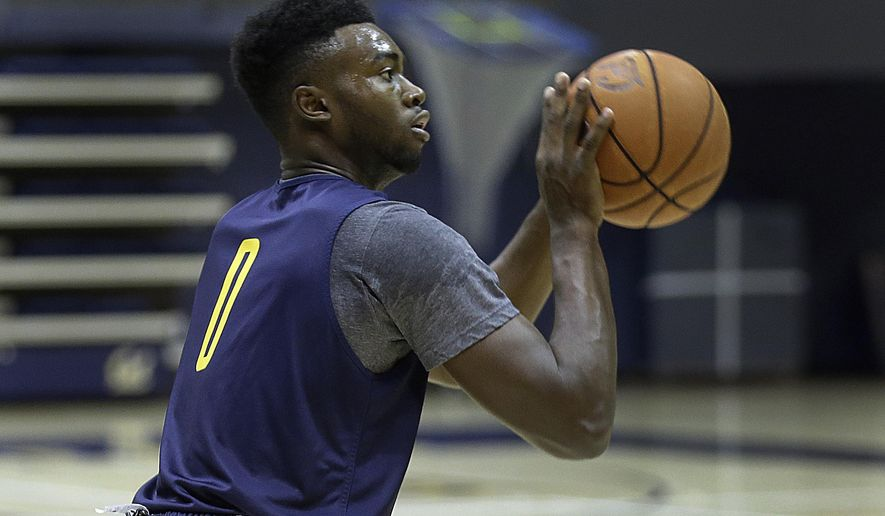 FILE - In this Oct. 7, 2015, file photo, California's Jaylen Brown shoots during basketball practice in Berkeley, Calif. Freshmen Brown and Ivan Rabb are two star California recruits ready to take the program to the next level under second-year Golden Bears coach Cuonzo Martin. (AP Photo/Ben Margot, file)