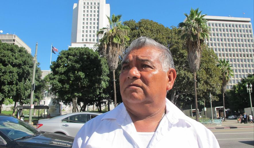 Aureliano Santiago, a Los Anegels street vendor, comments Thursday, Oct. 29, 2015, in Los Angeles, about his federal civil rights lawsuit that accuses the city of illegally destroying the property of street vendors  Street vendors in the trendy Fashion District of downtown Los Angeles sued the city and the neighborhood's business improvement district, accusing them of harassment, illegally destroying their carts and other property, and threatening some with deportation. The lawsuit was filed in federal court Wednesday by the Legal Aid Foundation of Los Angeles and other civil rights groups. (AP Photo/Amanda Lee Myers)