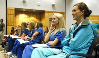 University of Mississippi Medical School students laugh as Jeffrey S. Vitter, makes a joke during a visit to the Jackson, Miss., campus, Wednesday, Oct. 28, 2015. (AP Photo/Rogelio V. Solis)  **FILE**