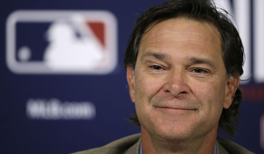 FILE - In this Oct. 5, 2015, file photo, Los Angeles Dodgers manager Don Mattingly speaks during a news conference in St. Louis. TA person familiar with the situation says Don Mattingly has been hired as manager of the Miami Marlins less than a week after he parted with the Dodgers. The person spoke to The Associated Press on condition of anonymity Thursday, Oct. 29, 2015, because the decision hasn't been publicly confirmed. The announcement might not come until after the World Series. (AP Photo/Charlie Neibergall, File)