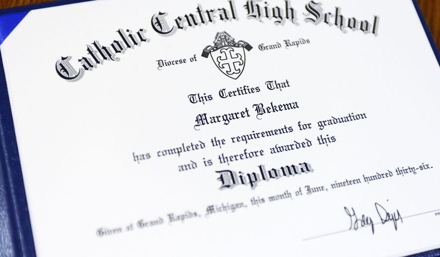 This photo shows the honorary diploma awarded to 97-year-old Margaret Thome Bekema at Stonebridge Manor on Thursday, Oct. 29, 2015 in Grand Rapids, Mich.. Bekema began her education at Catholic Central in 1932 but sacrificed completing her degree at that time to take care of her mother who had cancer and her younger siblings. (Emily Rose Bennett/The Grand Rapids Press via AP) ALL LOCAL TELEVISION OUT; LOCAL TELEVISION INTERNET OUT; MANDATORY CREDIT (Emily Rose Bennett | MLive.com)