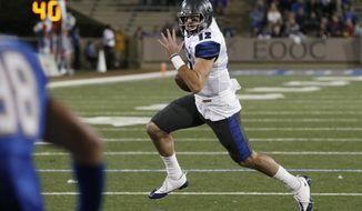 Memphis quarterback Paxton Lynch carries on a touchdown run during the third quarter of an NCAA college football game against Tulsa in Tulsa, Okla., Friday, Oct. 23, 2015. Memphis won 66-42. (AP Photo/Sue Ogrocki)