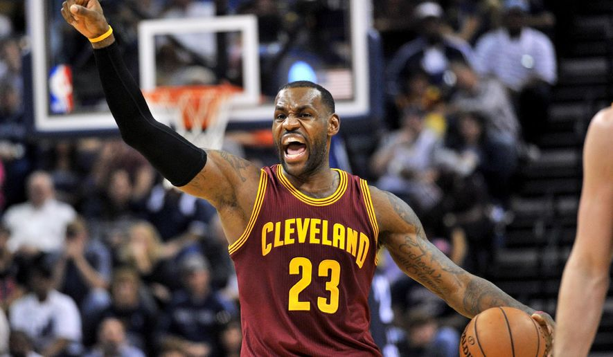 Cleveland Cavaliers forward LeBron James (23) calls to players while moving the ball downcourt in the first half of an NBA basketball game against the Memphis Grizzlies, Wednesday, Oct. 28, 2015, in Memphis, Tenn. (AP Photo/Brandon Dill)