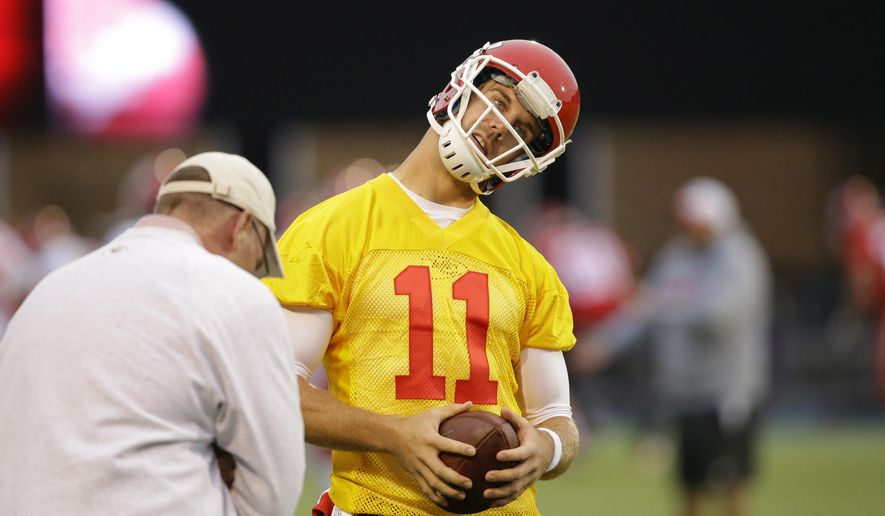 Kansas City Chiefs quarterback Alex Smith takes part in an NFL practice session at the Allianz Park rugby stadium in London, Friday, Oct. 30, 2015.  The Detroit Lions are due to play the Kansas City Chiefs at Wembley stadium in London on Sunday in a regular season NFL game. (AP Photo/Matt Dunham)