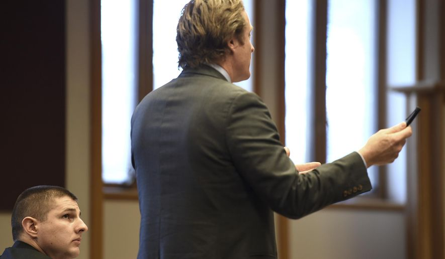 Windsor Police Officer Ryan Palmer, left, who has been charged with unlawfully shooting a suspect during a drug sting, listens to his attorney Daniel Sedon during a hearing in Windsor Superior Court on Friday, Oct. 30, 2015, in White River Junction, Vt. Palmer is seeking a one-day permit to possess a weapon, a measure that would allow him to maintain his patrol rifle certification while he continues to serve as the department's only firearms instructor.  (Jennifer Hauck/The Valley News via AP) MANDATORY CREDIT