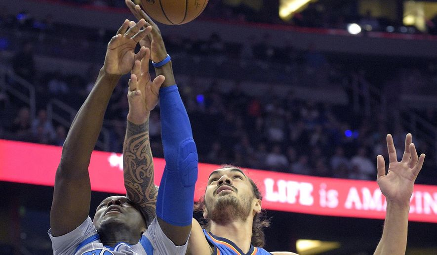 Orlando Magic guard Victor Oladipo (5) is fouled by Oklahoma City center Steven Adams, right, while fighting for a rebound during the first half of an NBA basketball game in Orlando, Fla., Friday, Oct. 30, 2015. (AP Photo/Phelan M. Ebenhack)