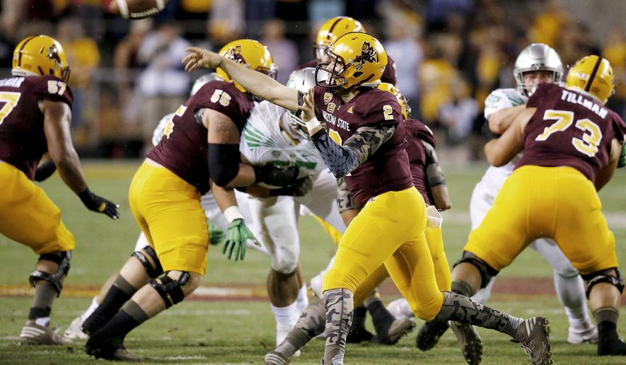 Arizona State's Mike Bercovici (2) throws the football against Oregon during the first half of an NCAA college football game Thursday, Oct. 29, 2015, in Tempe, Ariz. (AP Photo/Ross D. Franklin)