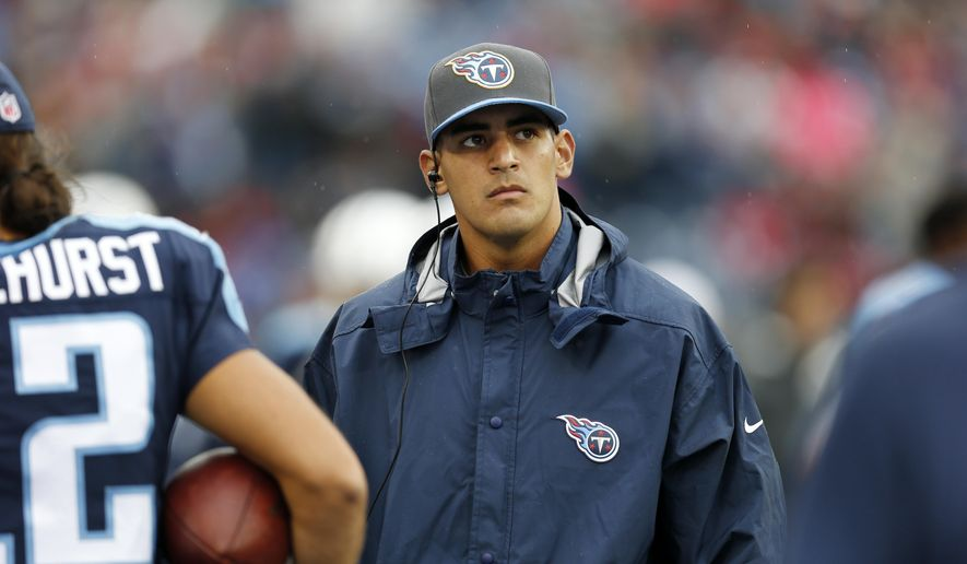 FILE - In this Oct. 25, 2015, file photo, injured Tennessee Titans quarterback Marcus Mariota watches the scoreboard in the second half of an NFL football game against the Atlanta Falcons in Nashville, Tenn. Mariota has been able to practice in a limited fashion the past two days, and Tennessee officials hope he can do more Friday. The rookie's sprained left knee will need to be healthy to play Sunday against Houston and J.J. Watt.  (AP Photo/Weston Kenney, File)