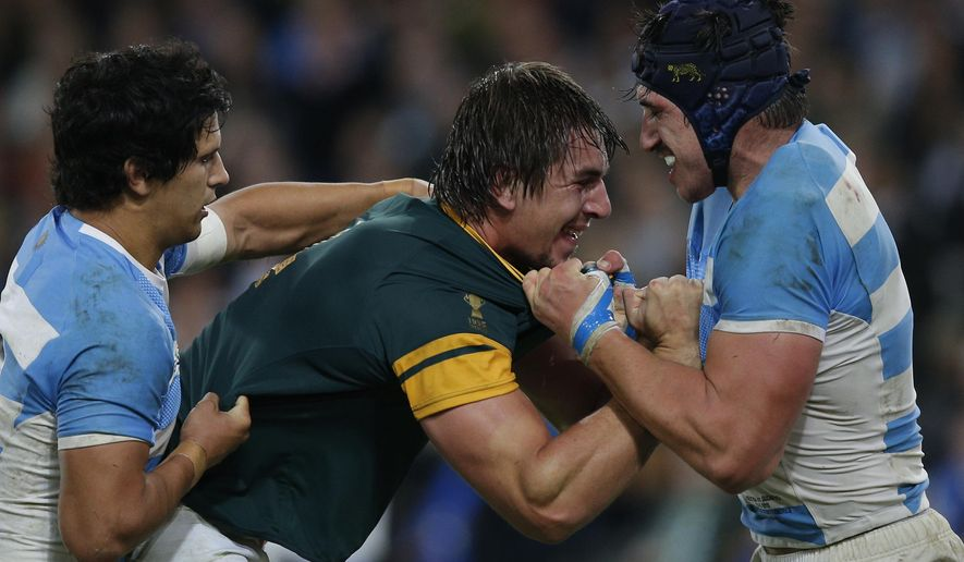 South Africa's Eben Etzebeth is tackled by Argentina's Tomas Lavanini, right, during the bronze medal Rugby World Cup match between South Africa and Argentina at the Olympic Stadium, London, Friday, Oct. 30, 2015. (AP Photo/Christophe Ena)
