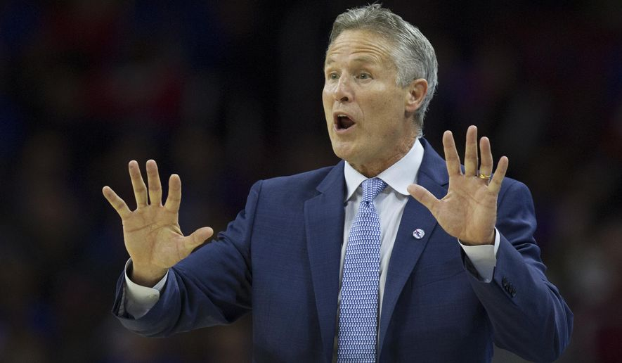 Philadelphia 76ers coach Brett Brown shouts from the bench in the first half of an NBA basketball game against the Utah Jazz, Friday, Oct. 30, 2015, in Philadelphia. (AP Photo/Laurence Kesterson)