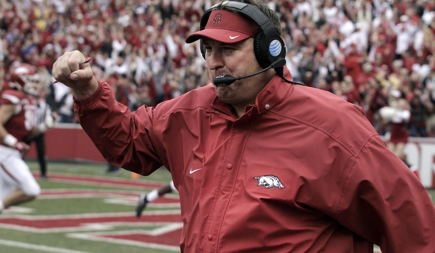 Arkansas' Bret Bielema celebrates after a touchdown during the fourth overtime of an NCAA college football game against Auburn, Saturday, Oct. 24, 2015, in Fayetteville, Ark. Arkansas won 54-46 in four overtimes. (AP Photo/Samantha Baker)