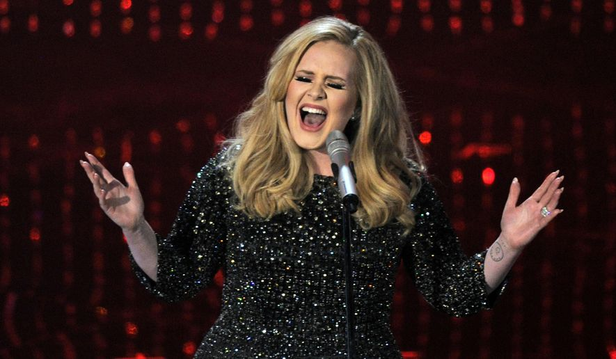 """FILE - In this Feb. 24, 2013 file photo, Adele performs during the Oscars at the Dolby Theatre in Los Angeles.  NBC said Friday, Oct. 30, 2015,  that the singer will tape a concert at New York's Radio City Music Hall in November, to be shown in a one-hour prime-time special on Dec. 14. The Grammy Award-winner just released her new song """"Hello"""" with a full album upcoming. (Photo by Chris Pizzello/Invision/AP)"""
