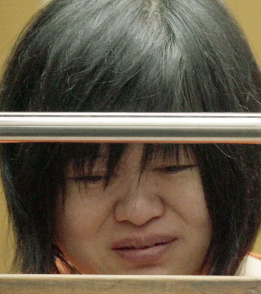 """FILE - In this  March 16, 2012, file photo, Dr Hsiu Ying """"Lisa"""" Tseng listens in court during her arraignment, in Los Angeles. The Rowland Heights doctor was convicted Friday, Oct. 30, 2015, of three counts of second-degree murder for prescribing massive quantities of addictive and dangerous drugs to patients with no legitimate need, three of whom died of overdoses, the Los Angeles County District Attorney's Office announced. (AP Photo/Nick Ut, File)"""