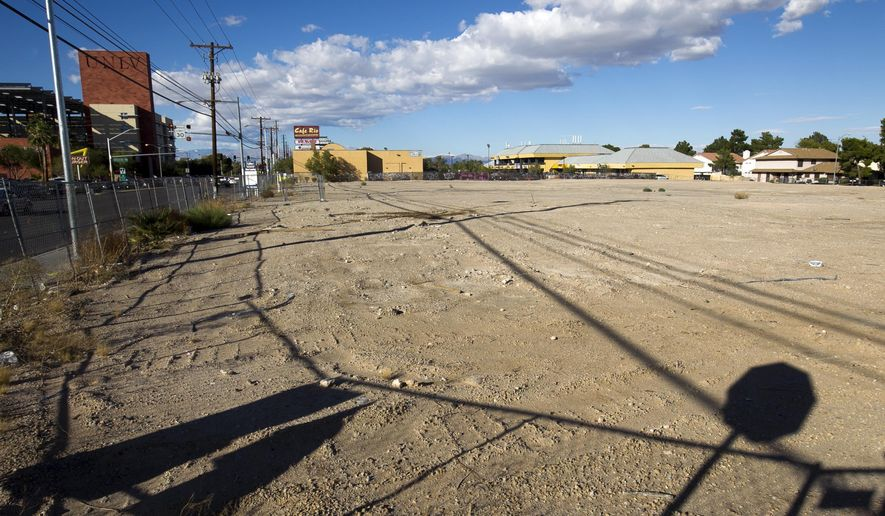 This Oct. 21, 2015 photo shows the lot at 4700 S. Maryland Parkway near UNLV in Las Vegas. The former strip mall, which housed the Freakin' Frog Cafe & Beer Bar as well as other businesses, is in the process of redevelopment. (Steve Marcus/Las Vegas Sun via AP) LAS VEGAS REVIEW-JOURNAL OUT; MANDATORY CREDIT