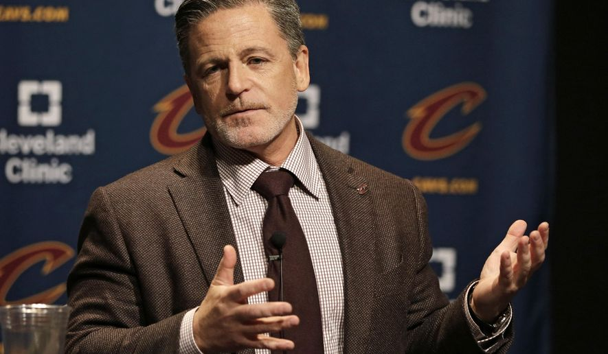 Cleveland Cavaliers owner Dan Gilbert answers questions before an NBA basketball game between the Miami Heat and the Cleveland Cavaliers, Friday, Oct. 30, 2015, in Cleveland. (AP Photo/Tony Dejak)