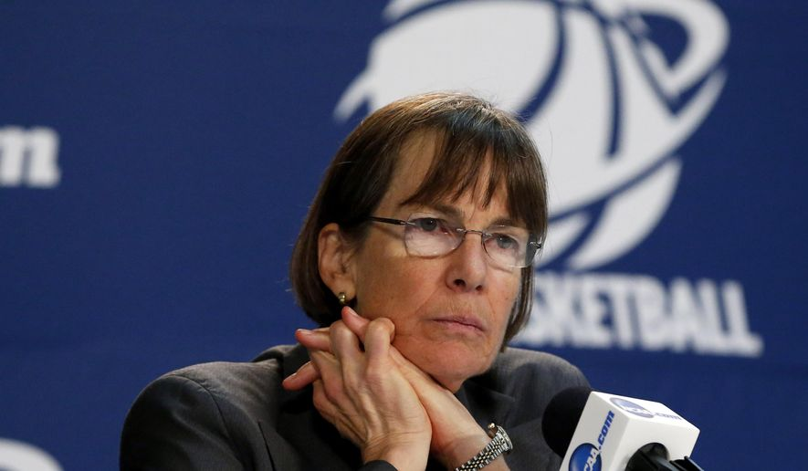 FILE - In this March 27, 2015, file photo, Stanford coach Tara VanDerveer listens during a news conference after a women's college basketball regional semifinal game against Notre Dame in the NCAA tournament in Oklahoma City. VanDerveer tunes in to as many Golden State Warriors games as she can catch on television. The Hall of Fame Stanford coach watched the NBA champions practice on campus earlier this month. (AP Photo/Sue Ogrocki, File)