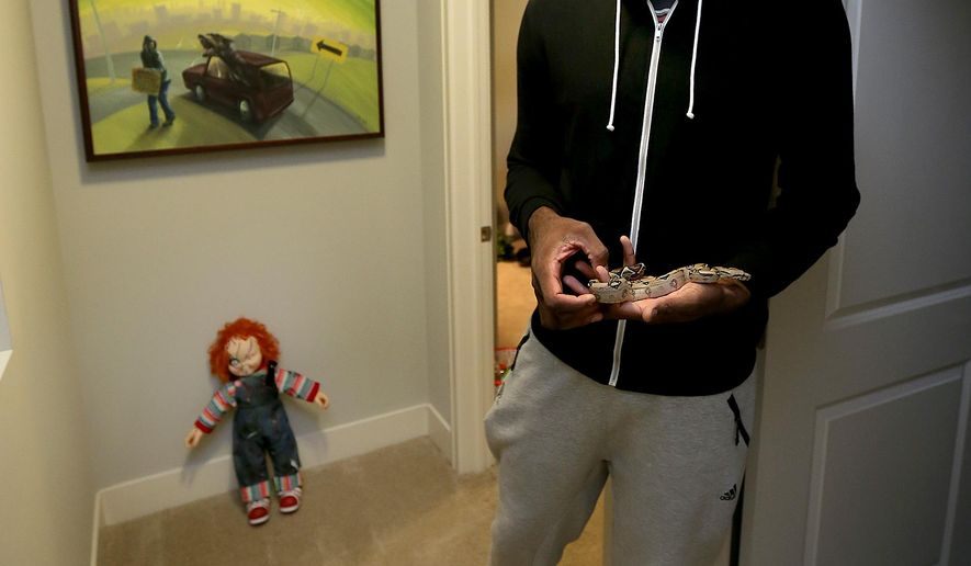 In this Oct. 26, 2015, photo, Indiana Pacers rookie Rakeem Christmas holds his pet snake in his apartment in Indianapolis. (Matt Kryger/The Indianapolis Star via AP)  NO SALES; MANDATORY CREDIT
