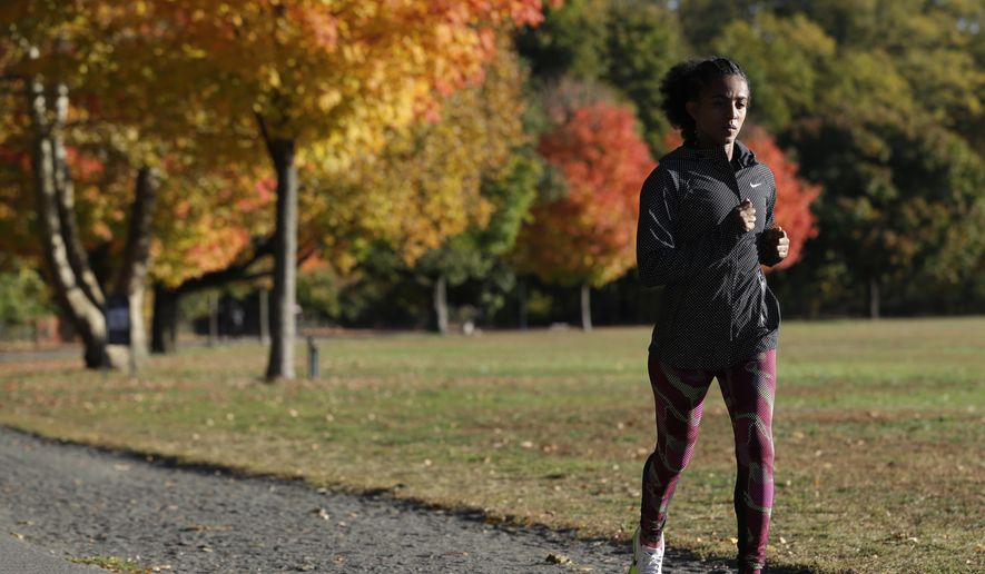 In this Oct. 26, 2015, photo, Buzunesh Deba demonstrates her running form at Van Cortlandt Park in the Bronx section of New York. Deba, a two-time runner-up, is seeking to become the first New Yorker in more than four decades to win the city's marathon.(AP Photo/Seth Wenig)