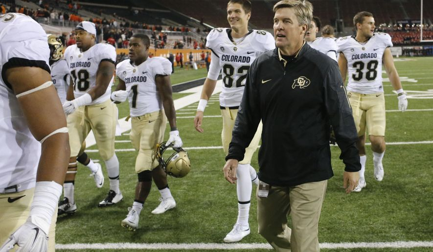 Colorado coach Mike Macintyre, right, leaves the field with his players after Colorado defeated Oregon State 17-13 in an NCAA college football game in Corvallis, Ore., on Saturday, Oct. 24, 2015.(AP Photo/Timothy J. Gonzalez)