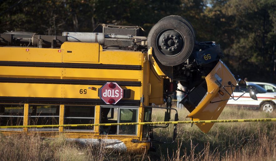Caroline County Public Schools bus #59 lies overturned after colliding with a minivan near Caroline High School in Caroline County, Va., on Friday, Oct. 30, 2015. Over two dozen students were injured in the accident. (Sarah Ann Jump /The Free Lance-Star via AP) MANDATORY CREDIT