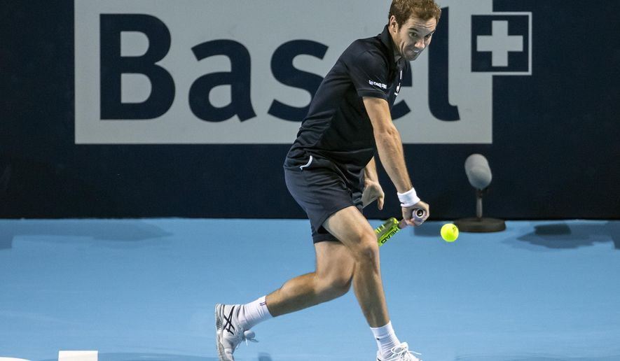 France's Richard Gasquet returns a ball to Croatia's Ivo Karlovic during their quarter final match at the Swiss Indoors tennis tournament at the St. Jakobshalle in Basel, Switzerland, Friday, Oct. 30, 2015. (Alexandra Wey/Keystone via AP)