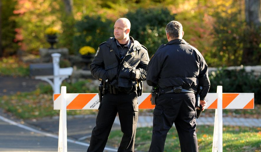 Police officers stand at the scene of a search around a home in Weston, Conn., on Friday, Oct. 30, 2015, reportedly belonging to a friend of Kyle Navin. Possible human remains were found during the search and may be linked to the disappearance of missing Easton couple, Jeanette and Jeffery Navin, Kyle Navin's parents. (Cathy Zuraw /Hearst Connecticut Media via AP) ** FILE **