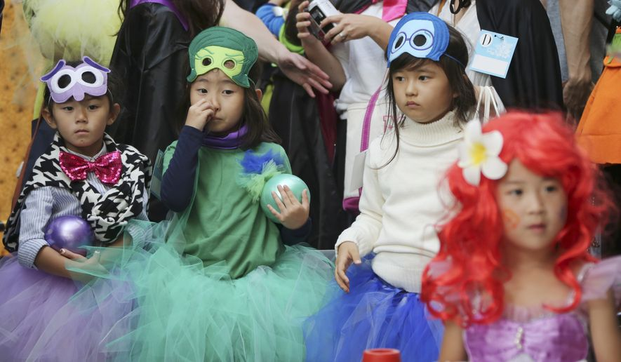 In this Oct. 24, 2015, file photo, participants parade during an annual Halloween event in Kawasaki, near Tokyo. Although Japan has its own traditional festivals to celebrate spookiness and honor the dead, Halloween is being observed with a special frenzy. (AP Photo/Koji Sasahara)