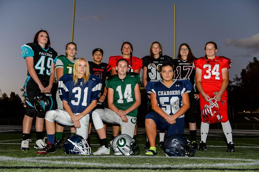 Several of the girls playing high school football in Utah pose for a portrait Wednesday, Oct. 21, 2015, in Salt Lake City. Front row, from left, are Abby Pruitt, of Layton, Ashley Denning, of Olympus, and Bailie Appleton, of Corner Canyon. Back row, left to right, are Morgan Cheney, of Canyon View, Taylor Stevens, of Clearfield, Izzy Martinez, of West, Morgan Lukrich, of Park City, Jacquelyn Hanks, of Alta, Jacinda Riehm, of Jordan, and Emmalee Mayes, of Uintah. (Trent Nelson/The Salt Lake Tribune via AP) DESERET NEWS OUT; LOCAL TELEVISION OUT; MAGS OUT; MANDATORY CREDIT