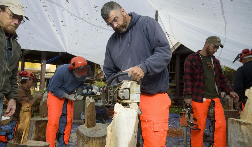 ADVANCE FOR WEEKEND EDITIONS OCT. 31-NOV. 1 - In this Oct. 18, 2015 photo, U.S. Army Sgt. Ray King, an Iraq war veteran joins other servicemen at the American Legion Post 43 for part of the 21st Century Heroes wood-carving camp In Jackson, Wyo. 21st Century Heroes is a nonprofit organization that aims to support veterans' mental health by teaching them new skills. (Price Chambers/Jackson Hole News & Guide via AP) MANDATORY CREDIT