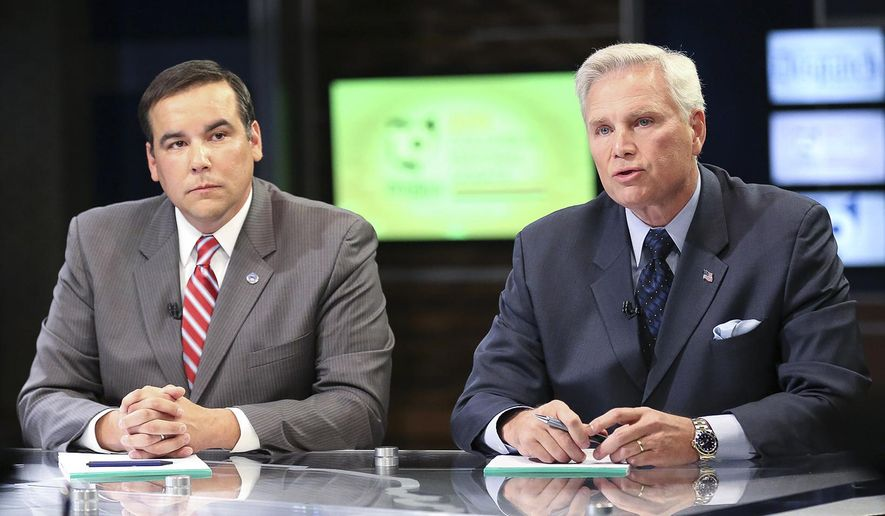 "FILE - In this file photo taken Tuesday, Oct. 20, 2015, Columbus, Ohio, City Council President Andrew J. Ginther, left, and Franklin County, Ohio, Sheriff Zach Scott, right, competing to replace outgoing Columbus, Ohio, Mayor Michael B. Coleman, participate in a debate at WBNS 10TV in Columbus, Ohio. The ""off-off year"" statewide election scheduled Tuesday, Nov. 3, 2015, has been overshadowed by higher profile 2016 races, but will decide the fate of three ballot proposals _ on legislative redistricting, constitutional monopolies and marijuana legalization _ and a host of local candidate contests and issues. (Fred Squillante/The Columbus Dispatch via AP, File) MANDATORY CREDIT"
