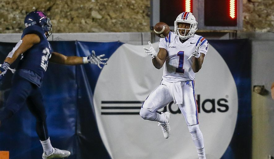 Louisiana Tech wide receiver Carlos Henderson (1) makes a catch in the back of the end zone for a touchdown against Rice cornerback Ryan Pollard (22) during an NCAA college football game Friday, Oct. 30, 2015, in Houston. (Bob Levey/Houston Chronicle via AP) MANDATORY CREDIT