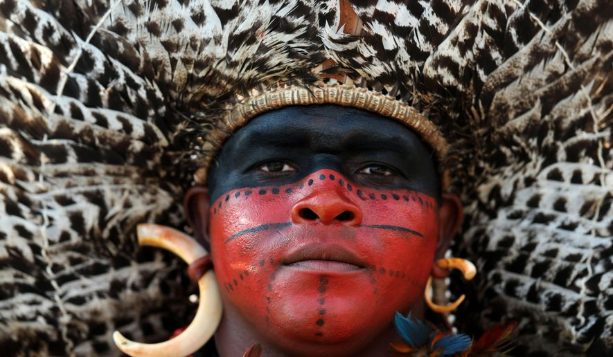 A Pataxo Indian, of Brazil, attends the World Indigenous Games in Palmas, Brazil, Thursday, Oct. 29, 2015. Organizers billed the nine-day event as a sort of indigenous Olympics. (AP Photo/Eraldo Peres)