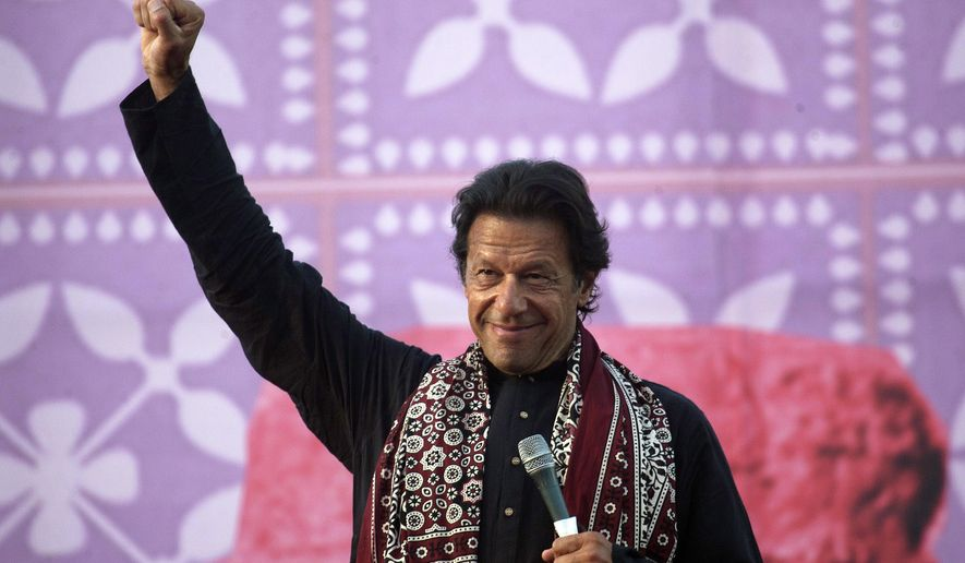 FILE - In this Friday, Nov. 21, 2014 file photo, Pakistan's cricketer-turned-politician Imran Khan gestures during an anti-government rally in Larkana, Pakistan. A spokesman says on Friday, Oct. 30, 2015 that Khan has divorced his wife Reham Khan after reaching a mutual agreement between the couple.(AP Photo/B.K. Bangash, File)