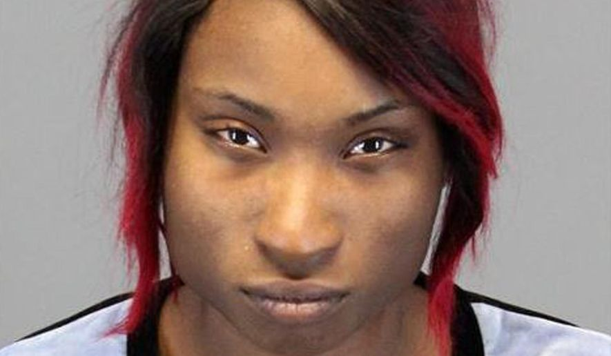This photo provided by the Auburn Hills, Mich., Police Department shows Breianna Smart of Pontiac, Mich. Smart was caught in a dash cam video on Oct. 23, 2015 in a confrontation with an officer that shows her backing up her car at high speed and slamming him into his patrol car in Auburn Hills. Smart was arrested and charged with fleeing and eluding police and assaulting, resisting or obstructing an officer causing injury. The policeman was hurt but has returned to work. (Auburn Hills Police Department via AP)