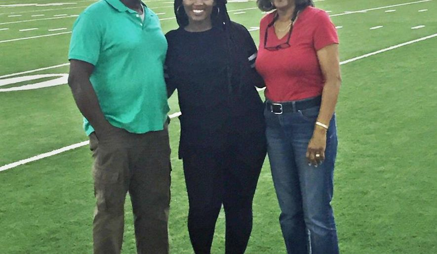 This photo made available by Nick Eason shows Bennie Brown Sr.,  of Vidalia, Ga., his daughter Kaja Brown and his wife Mary Brown at the Tennessee Titan's headquarters in Nashville, Tenn., Saturday, Oct. 24, 2015. Brown Sr. is the father-in-law of Titan's assistant defensive coach Nick Eason. Eason had invited the family to Nashville to watch the Titans host the Atlanta Falcons. Bennie Brown Sr. died Sunday morning, Oct. 25 of a heart attack.  (Nick Eason via AP)