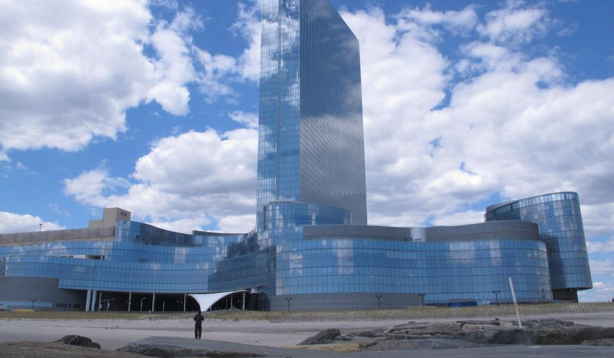 This April 29, 2015 photo shows the former Revel casino in Atlantic City, N.J. A bank says Revel's owner, Glenn Straub, owed $1 million in unpaid electric bills for the shuttered building. (AP Photo/Wayne Parry)